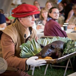 A smoked pig being presented at the Queen's Feast