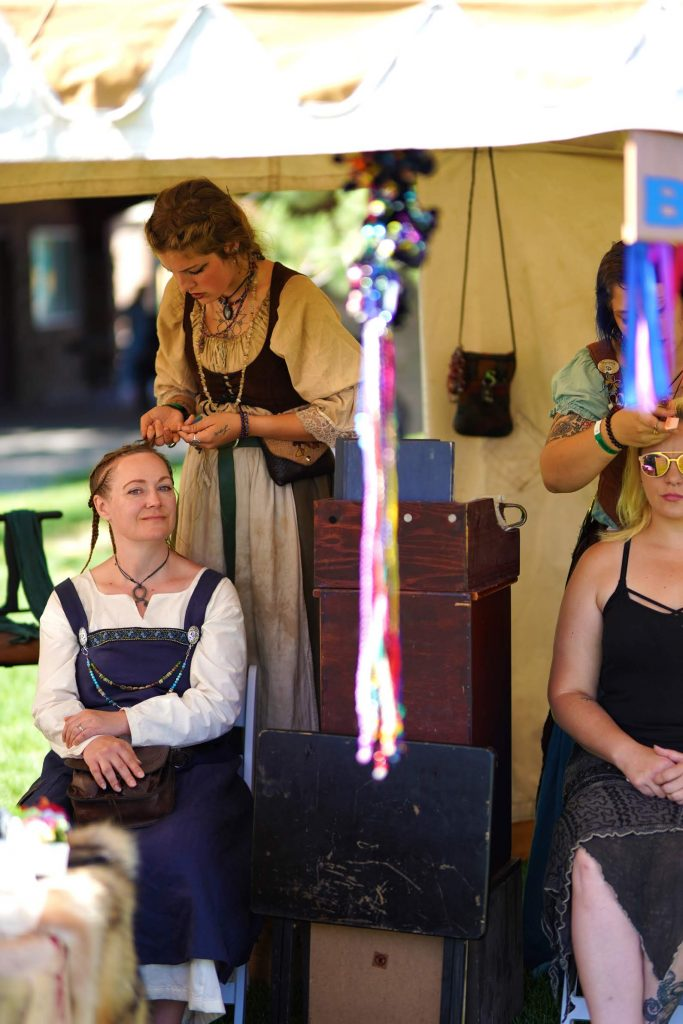 Hair braiding at the viking camp