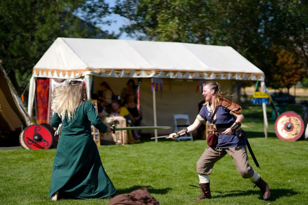 Women sword fighting at the viking camp